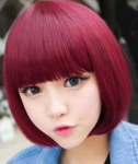 Asian women unique hair with bob style dyed in burgendy hair color with long bangs