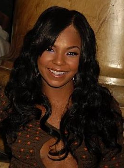 2011 African American hairstyle with full curls and very long length.PNG