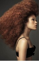 Woman extremely curly hairstyle photos with a very fashion and funky look.JPG