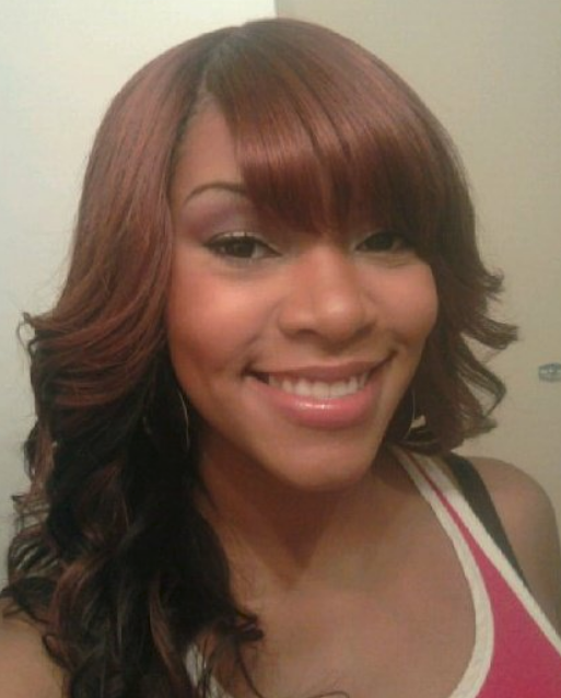 curly black women hairstyle with straight bang picture
