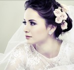 Elegant winder bridal hairstyle with fresh roses on low updo hairstyle with veil