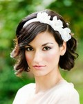 Short wavy bridal hairstyle with white floral headband with side bang