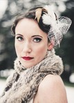 Unique wedding winter hairstyle with feathers hairclips