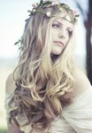 Vintagewedding haristyle with light curls and waves and flowers headbands