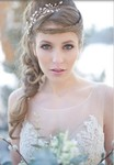 Winter bride updo with crystal headband with braided hearband with braid on the side