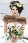 Winter wedding hairdo with large fresh flowers headband