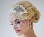 Winter wedding loose and low with crystal hairclip and net