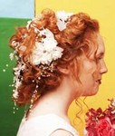 bride hairstyle, curls with flowers, red