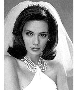 medium wedding hair style with headpiece and veil short