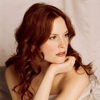 bride hairstyle with soft, flowing waves, reddish brown photo