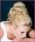 Wedding day hair style updo with clips, blond