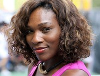 American female tennis player Serena Williams with her curly long bob hairstyle with long side bangs