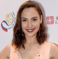Gal Gadot-Varsano with wavy medium hairstyle with swept bang