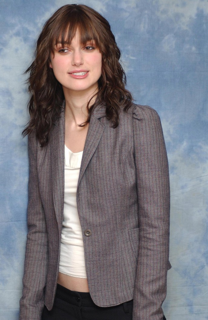 Knightley with long wavy and curly hair cut with long bang.jpg picture