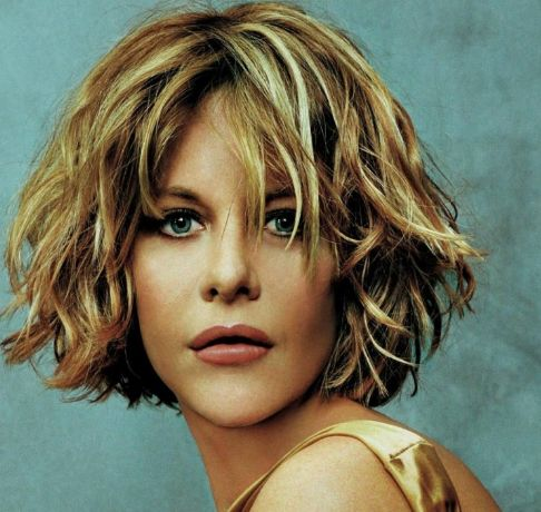 hairstyles with bangs and layers for long hair. Meg Ryan wavy short haircut with layers and long side bangs.