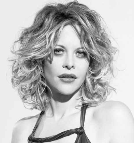 Meg Ryan with medium long wavy and curly hairstyle.