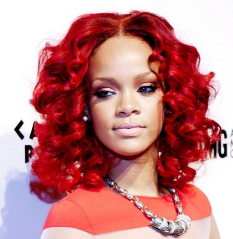 Rihanna Bright Red Hairstyle With Big Doll Curls With Long Side Curly