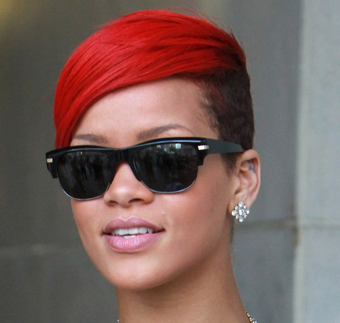 rihanna with her undercut short with red hair and black