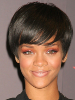 Rihanna with very short black hairstyle with long bang