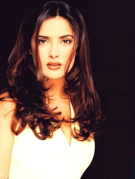 Salma Hayek with layered hairstyle with wavies and side long bangs.jpg