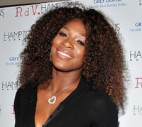 Serena Williams with beautiful long afro hairstyle with long curly side bangs