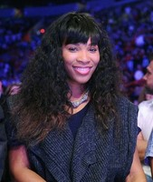 Young Serena Willams picture with her long curly hair with straight long bang