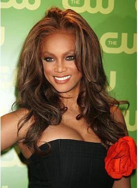 Tyra Banks with long wavy hairstyle