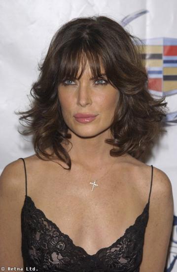 Lara Flynn Boyle with medium hair, wave, brown