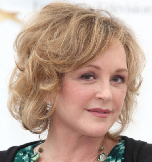 Blonde hair women hairstyle with curls for older women.PNG