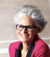 Mature women chic hairdo with bouncy top with gray hair