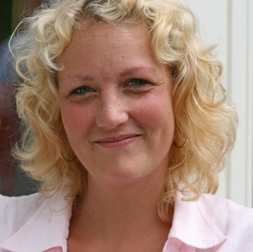 Older Women Blonde Curly Hairstyle With Curly Side Bangs