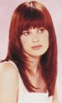 Long layered hair style with long form bangs, red