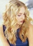 Long curly blonde hair style for woman