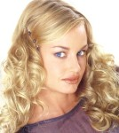 Long hair style with big soft curl, blonde