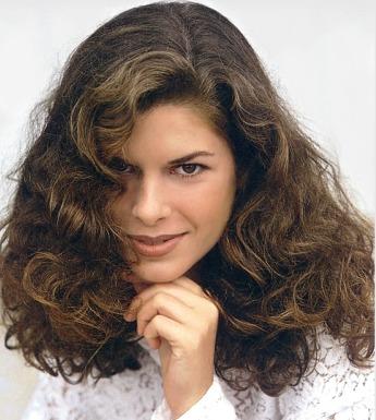Long hair style with big wavy curls, dark brown hair color