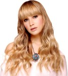 Long hair style with wavy tips, long form bangs, blonde