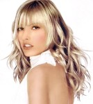 Long wavy hair style with bangs, blonde