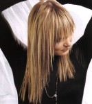 Long layered hair style with long bangs, blonde