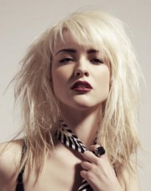 trendy punkish women hairstyle with layers and long bang_hair in ice blond.PNG