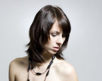 Medium long women hairstyle with full of layers and long bang.PNG
