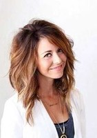 Wavy inverted bob hairstyle with highlights and super long side bangs gives you an edgy look