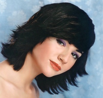 Mediun layered and wispy hair style with bangs, black