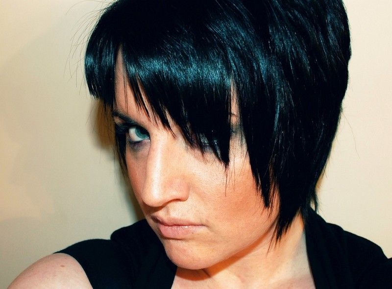 Black Short Hairstyle With Layers And Swept Bangs