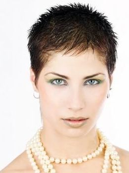 Young Woman Extreme Short Haircut With Spikes Photo