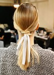 Medium long straight prom hairstyle with middle half updo with ribbons