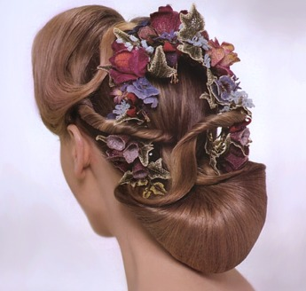 Updo hair style with blue flowers and red roses, brown