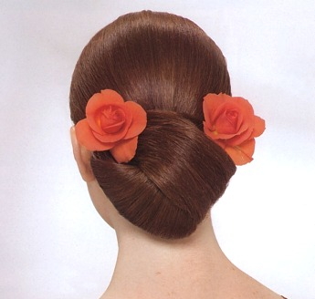 fancy updo hair style with red roses, brunette