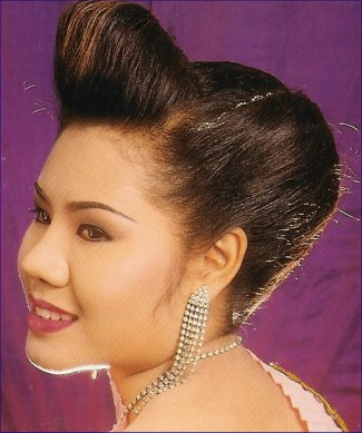 Updo hair style with big high sky bangs - updo in hair style