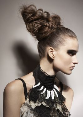 Women A Very Long And Very High Updo Her Hair Is Straight Back From Around The Sides Front And