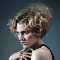 Crimped hairstyle with a heavily-layered lower half working up to a triangular bob with maximum volume at the back.jpg